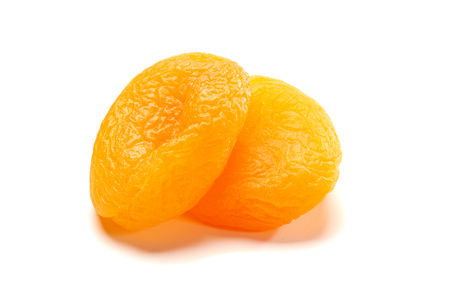 Two dried apricots on white Stock Photo