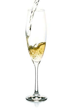 Champagne splash into the glass on white Reklamní fotografie
