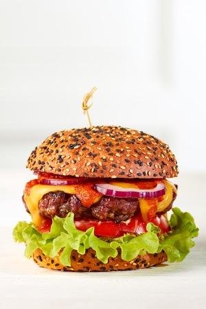 Tasty classic cheeseburger Stock Photo