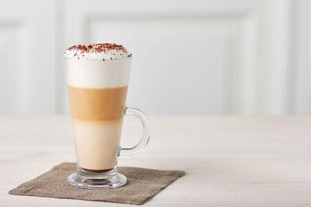 Glass cup of coffee latte on wooden table Stockfoto