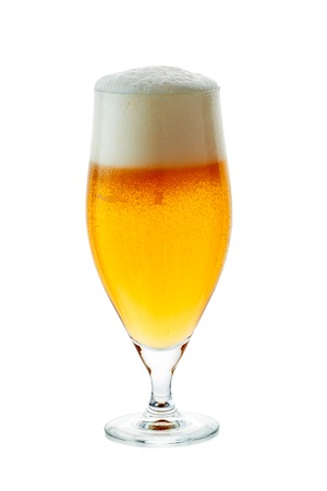 Glass of beer with foam on white