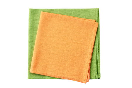 Stack of folded orange and pale green napkins isolated on white background Banco de Imagens - 113694308