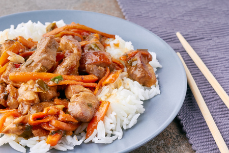 Dish of classic Chinesse sweet and sour pork with rice