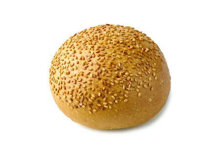 Bun for burger with sesame seeds on white