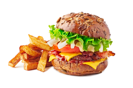 Hamburger with brown bun and french fries on white