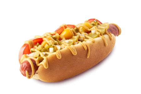 Hot dog with pickles and tomatoes on white