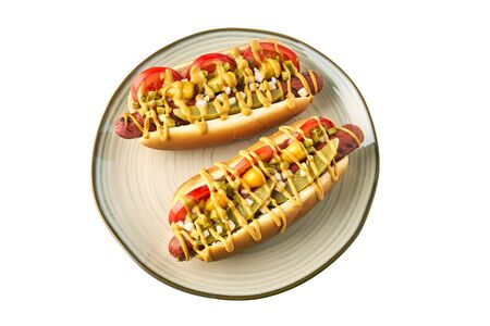 Two hot dogs on dish over white background Stock Photo