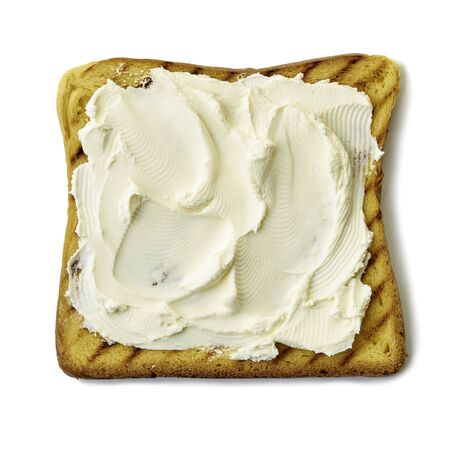 Roasted slice of toast bread with cream cheese on white