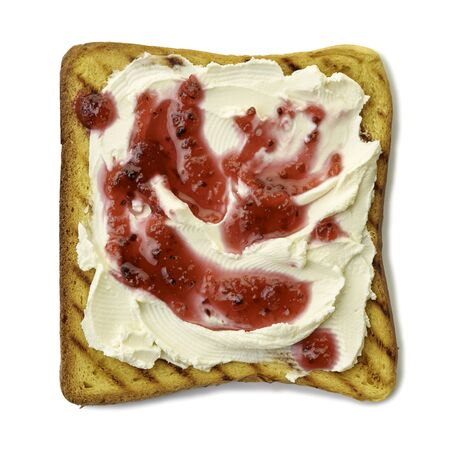 Roasted slice of toast bread with cream cheese and jam on white