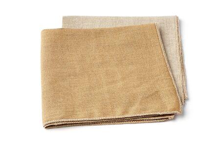 Beige and sandy textile napkins on white Reklamní fotografie