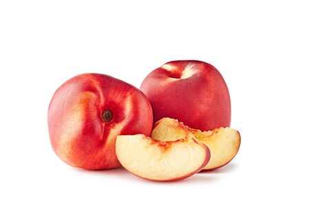 Two ripe nectarines with slices on white background Stock fotó