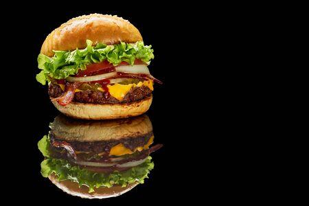 Hamburger with reflection on black background