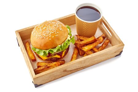 Wooden tray with hamburger, drink and french fries on white Фото со стока