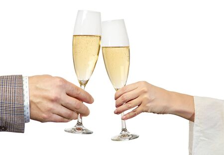 Male and female hands brings glasses of champagne on white