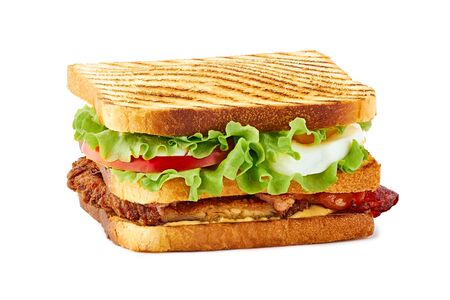 Club sandwich with fried chicken, bacon and egg on white