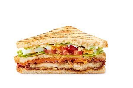 Slice of juicy club sandwich on white Фото со стока