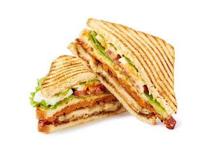 Two halves of club sandwich on white Фото со стока