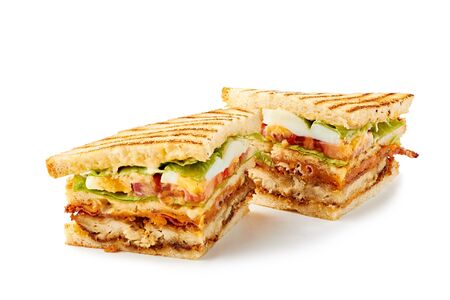 Two slices of club sandwich on white