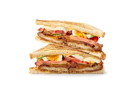 Two slices of juicy club sandwich on white