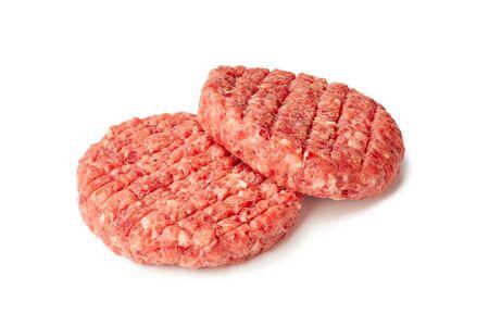 Two raw burger patties on white Фото со стока