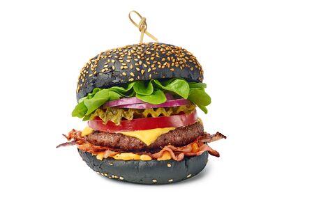 Huge black burger isolated on white
