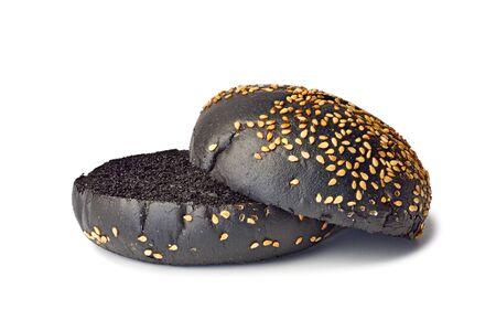 Halves of black hamburger bun on white