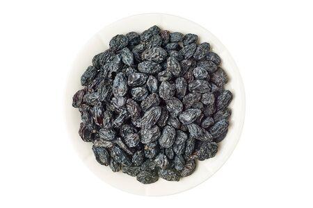 Bowl of black raisins on white