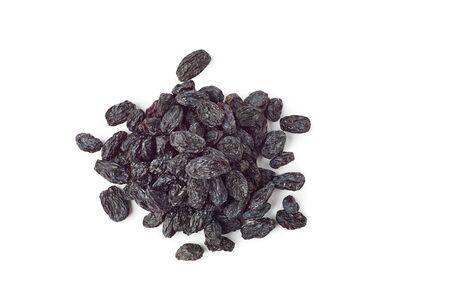 Heap of black raisins on white