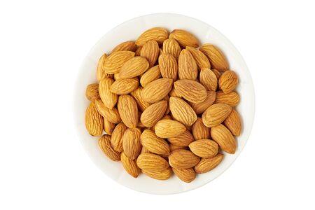 Bowl of raw almonds on white