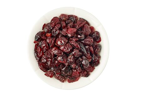 Bowl of dried cranberries on white