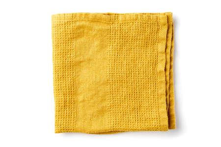 Folded yellow textile napkin on white