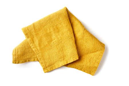 Crumpled yellow textile napkin on white