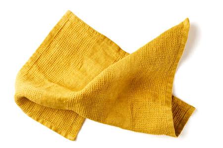 Crumpled yellow fabric napkin on white
