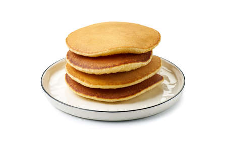 Dish with stacked pancakes on white