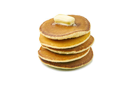 Stack of pancakes with butter piece on white Фото со стока