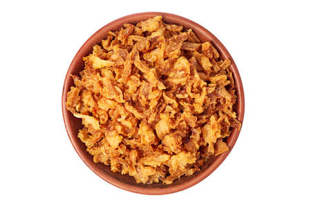 Bowl of crispy fried onions on white