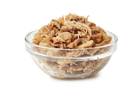 Glass bowl with pulled pork on white