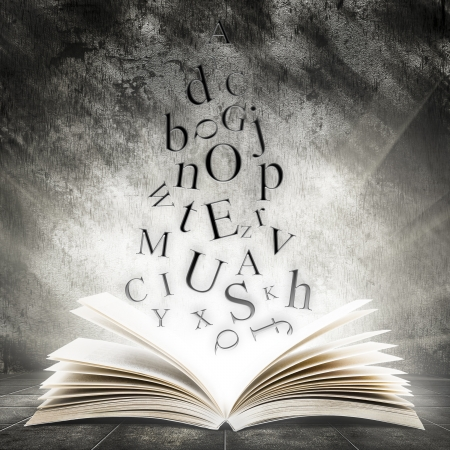 bible story: Old open book with magic light and falling letters on a dark abstract background Stock Photo