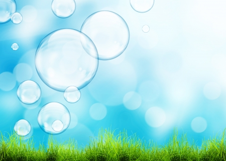 clean background: Flying soap bubbles and green grass over beauty natural background Stock Photo