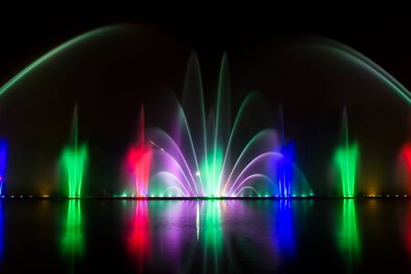 beauty fountain: Colored water fountain at night. Beauty background Stock Photo