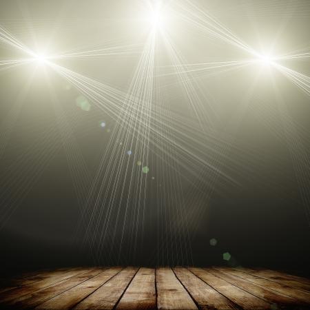 暗い背景と木製の床の上コンサートのスポット照明の小話