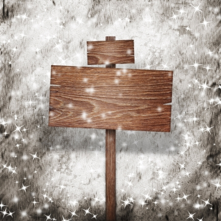 Wooden sign over snow grunge background
