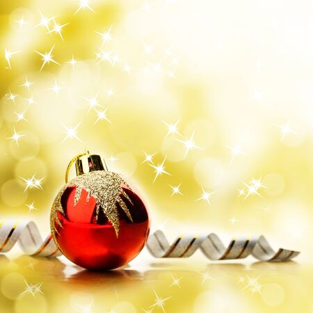 Red christmas toy over abstract bright yellow background photo
