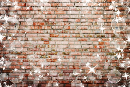 Old grunge brick wall with bright stars  Christmas concept background photo