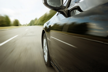 Blurred road and car, speed motion photo