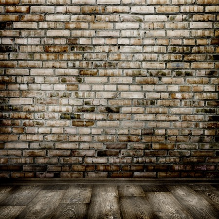 room interior vintage with brick wall and wood floor background photo