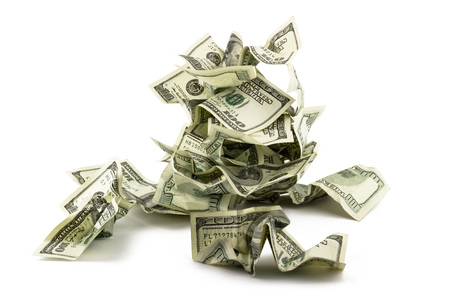 Pile of crumpled money dollar bills overs white background photo