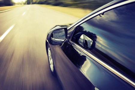 auto glass: Blurred road and car, speed motion background