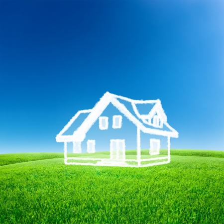 dream home: House from white clouds over blue sky with green field