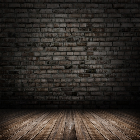 abandoned building: Dark room with tile floor and brick wall background